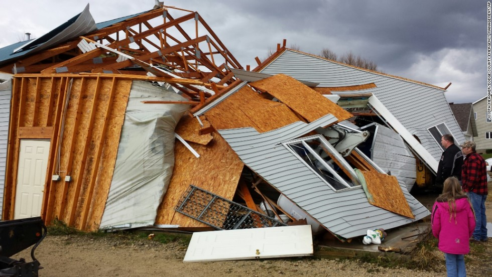 People survey storm damage on November 17 in Hustisford, Wisconsin, which is northwest of Milwaukee.