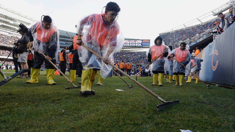Members of Soldier Field's ground crew prepare the field to resume play after a severe storm blew through the area on November 17 and suspended play during the first half of the game between the Chicago Bears and Baltimore Ravens.