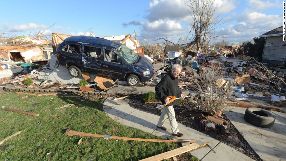 Richard Miller salvages items from his brother's home in Washington, Illinois, on November 17.
