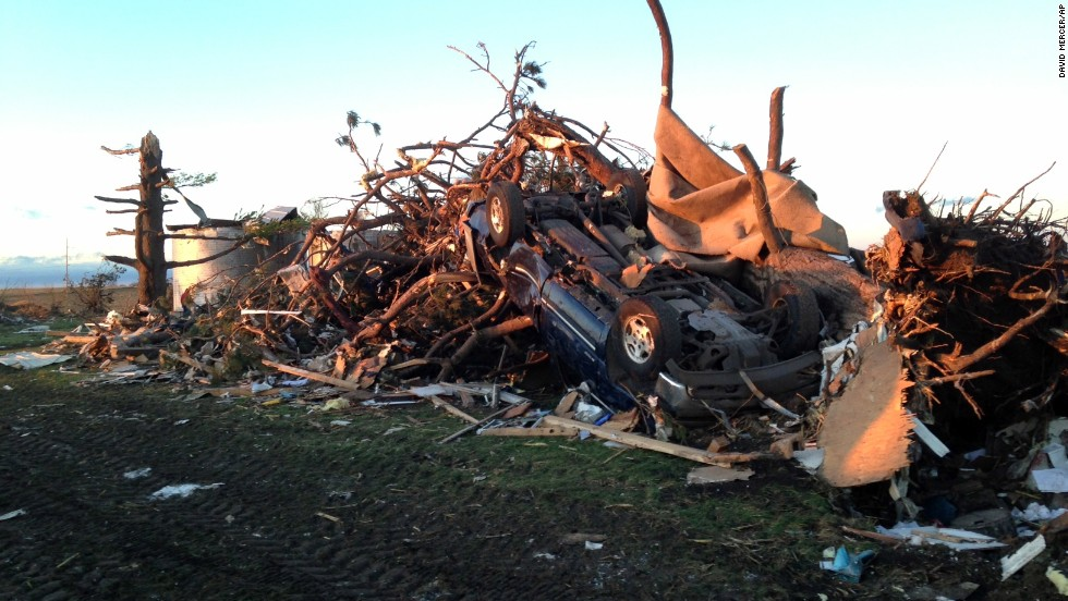 An overturned car rests in a pile of rubble about a mile northeast of Washington, Illinois, on November 17. Washington is in central Illinois, east of Peoria.