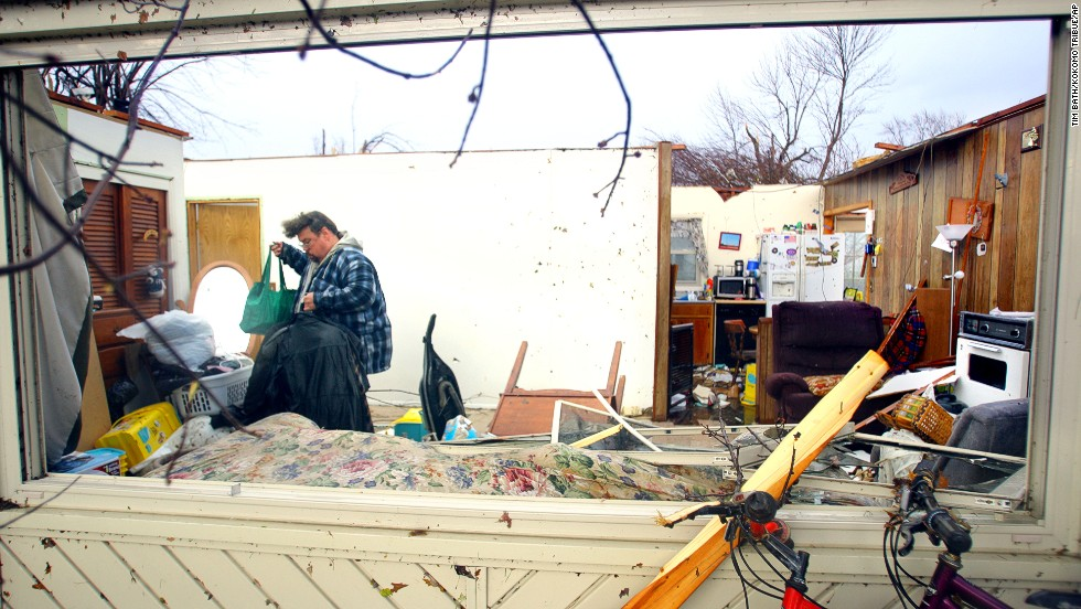 Dave Huffman sorts through his belongings in the living room of his destroyed home in Kokomo, Indiana, on November 17. Kokomo is almost 60 miles north of Indianapolis, the state capital.