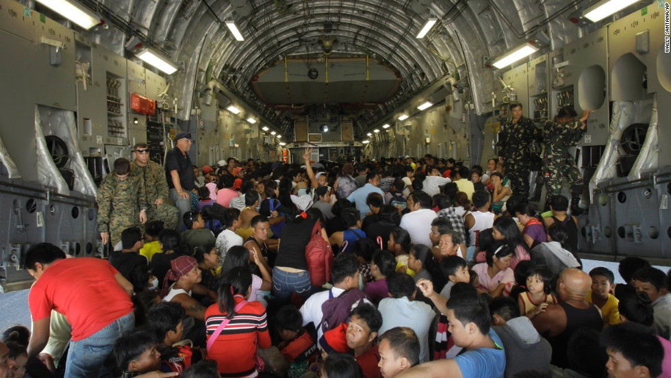 Hundreds of typhoon survivors are packed into a U.S. military airplane November 18 for evacuation from Tacloban's airport.