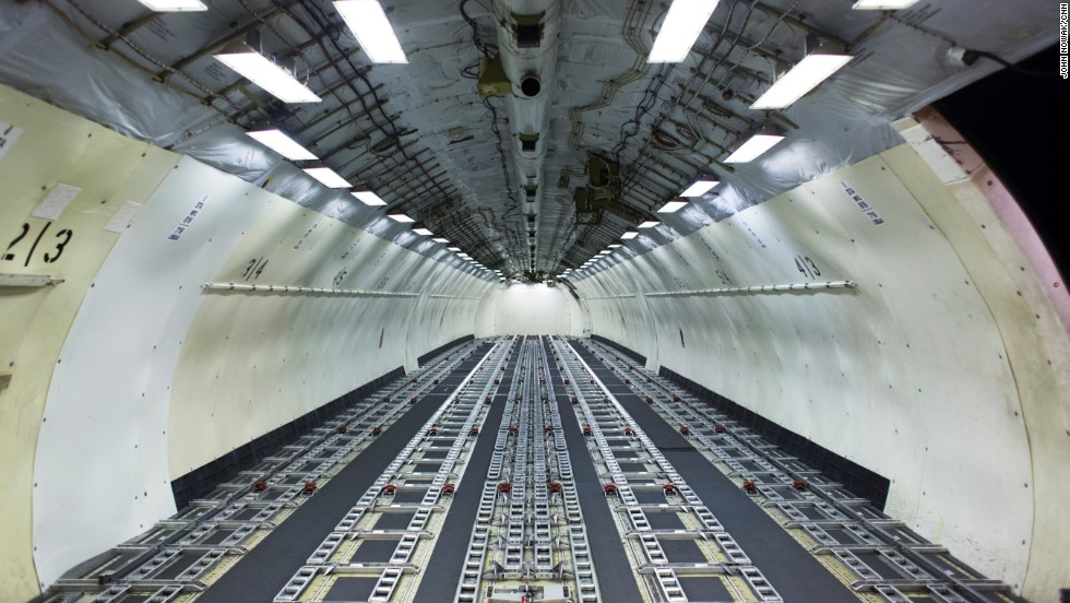 The interior of a cargo plane is barren as it awaits loading at the airport's UPS facility.
