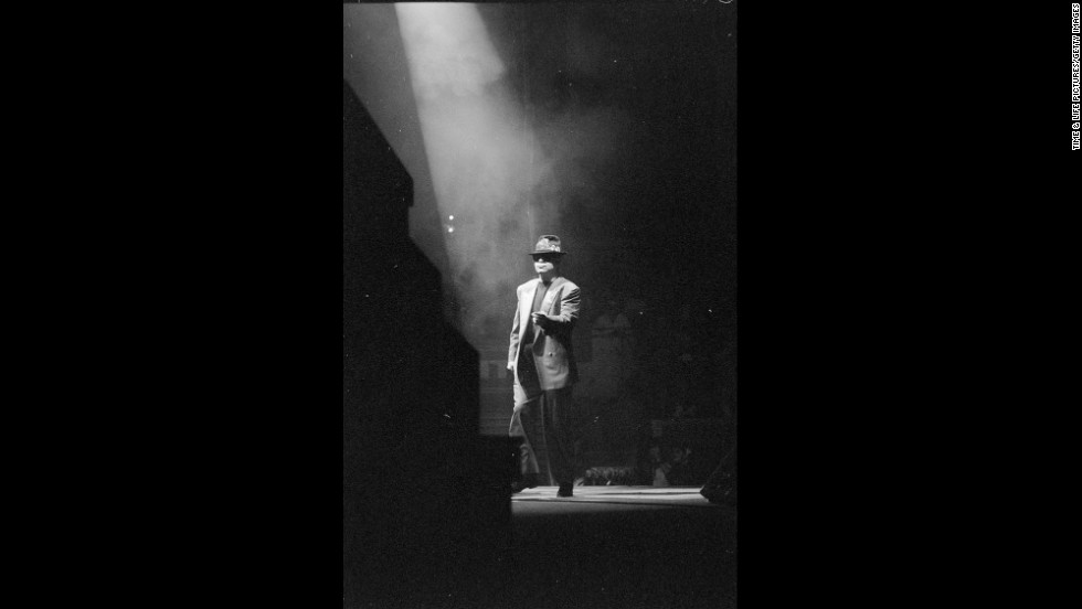 John walks on stage at New York's Madison Square Garden in 1989.
