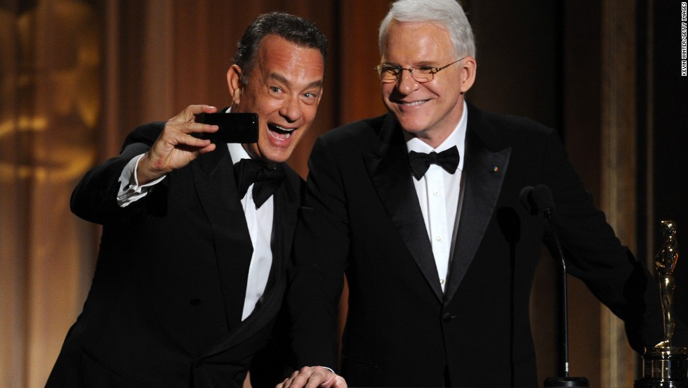 Tom Hanks takes a selfie with fellow actor Steve Martin at the 2013 Governors Awards.