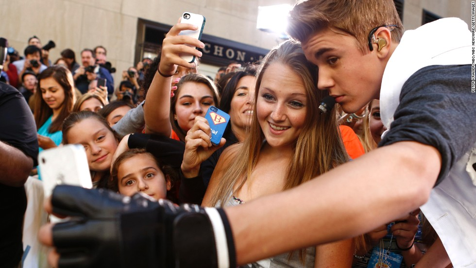 "Singer Justin Bieber takes a selfie with a fan before appearing on NBC's ""Today"" show."