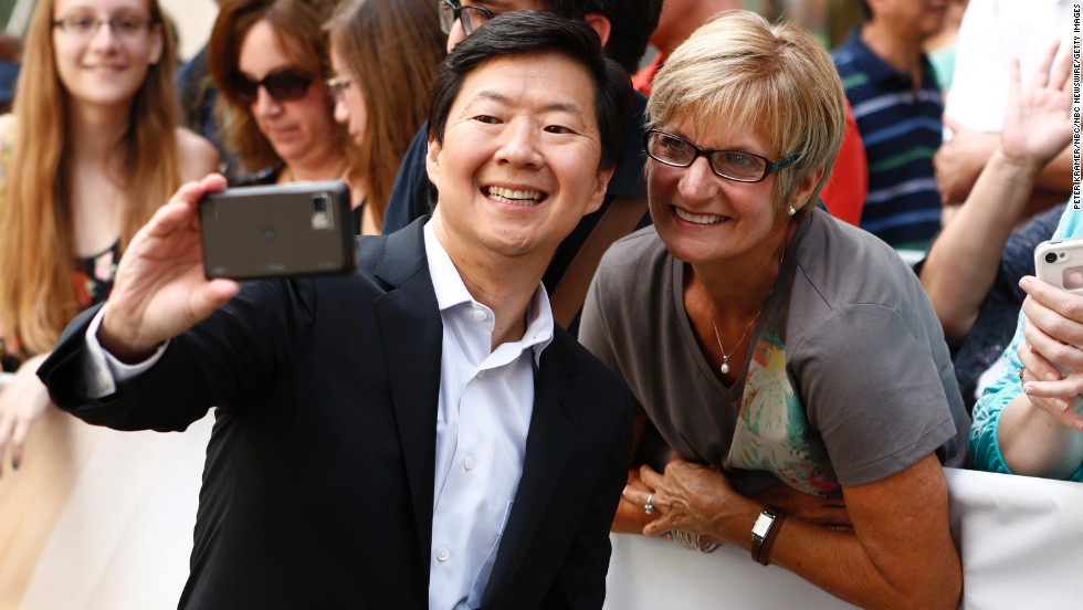 "Actor Ken Jeong takes a photo with a fan before appearing on NBC's ""Today"" show."