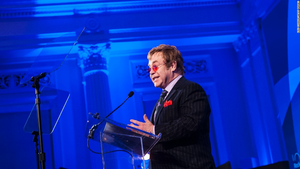 "John speaks after receiving the Lifetime Achievement Award during the Rockefeller Foundation's ""Celebration of American Philanthropy"" event in October 2013."