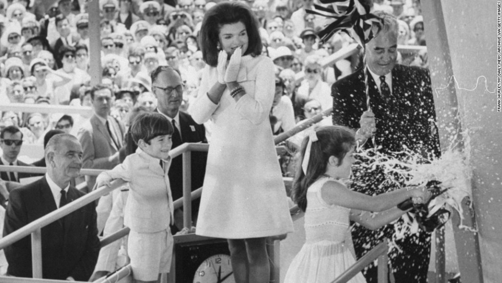 Caroline breaks a bottle of champagne on the bow of the USS John F. Kennedy during the aircraft carrier's christening in 1967.