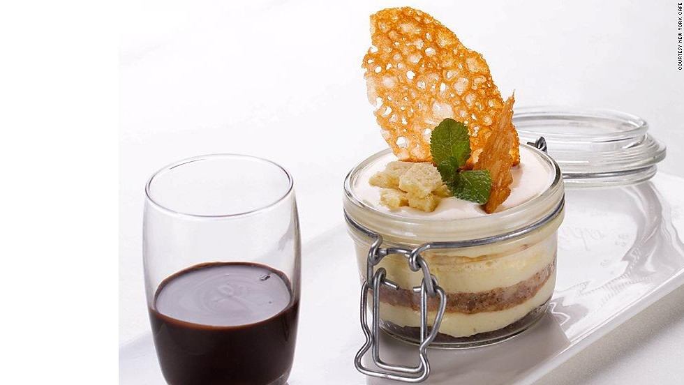 Not one but three types of sponge cake go into this luscious dessert. Fresh whipped cream, chocolate sauce and pungent rum bring the three layers of vanilla, chocolate and walnut together to form an exquisite dessert.