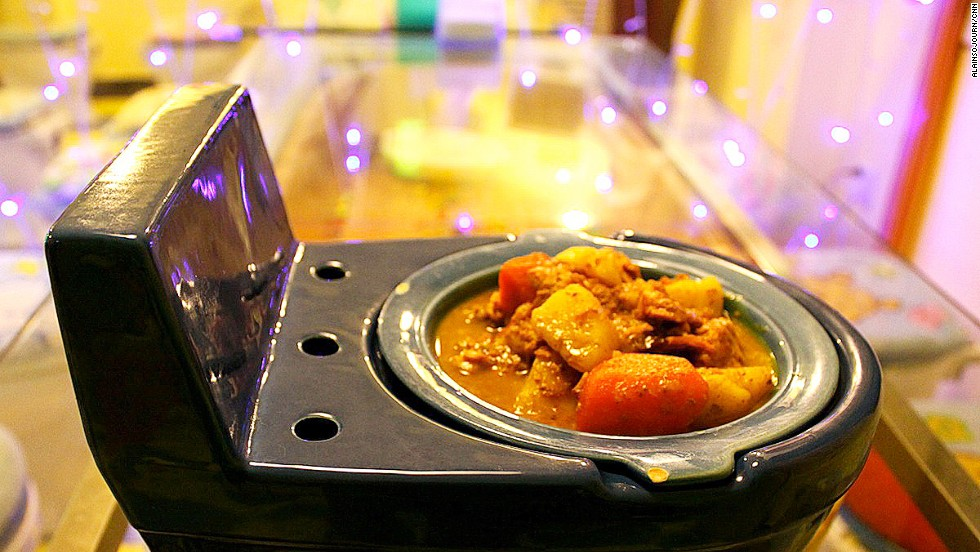 """At Beijing's toilet-themed restaurant, all 50 seats are made from actual toilet bowls, topped with cartoon-themed warmers. This particular dish? Beef curry in a toilet-shaped bowl. """"The food wasn't really that good,"""" says iReporter Alainsojourn. At least he walked away with these photos.<a href=""""http://travel.cnn.com/gallery-inside-beijings-toilet-restaurant-690726"""" target=""""_blank""""> Read more: Inside Beijing's toilet restaurant</a>"""