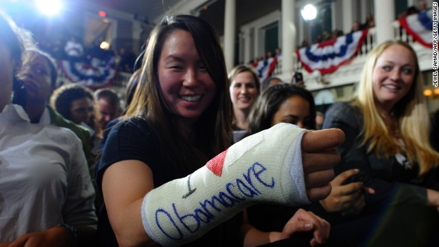 "Cathey Park shows her ""I heart Obamacare"" cast at an event in Boston where the president spoke. He later signed the cast."
