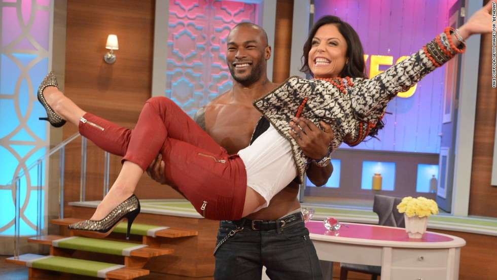 Bethenny Frankel gets a lift from model Tyson Beckford on her talk show 'bethenny' on November 18 in New York City.