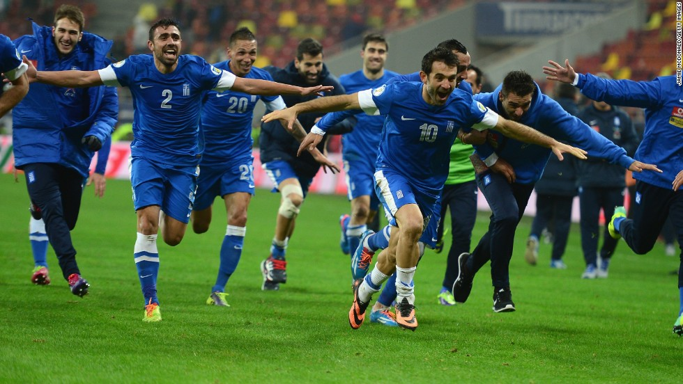 Greece's footballers provide some light relief for their compatriots when drawing 1-1 in Romania to reach the World Cup as convincing 4-2 aggregate winners.