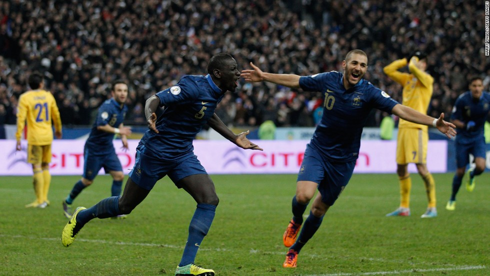 Mamadou Sakho and Karim Benzema celebrate as Ukraine score a late own goal to give France a 3-2 aggregate lead and a place in the European history books.