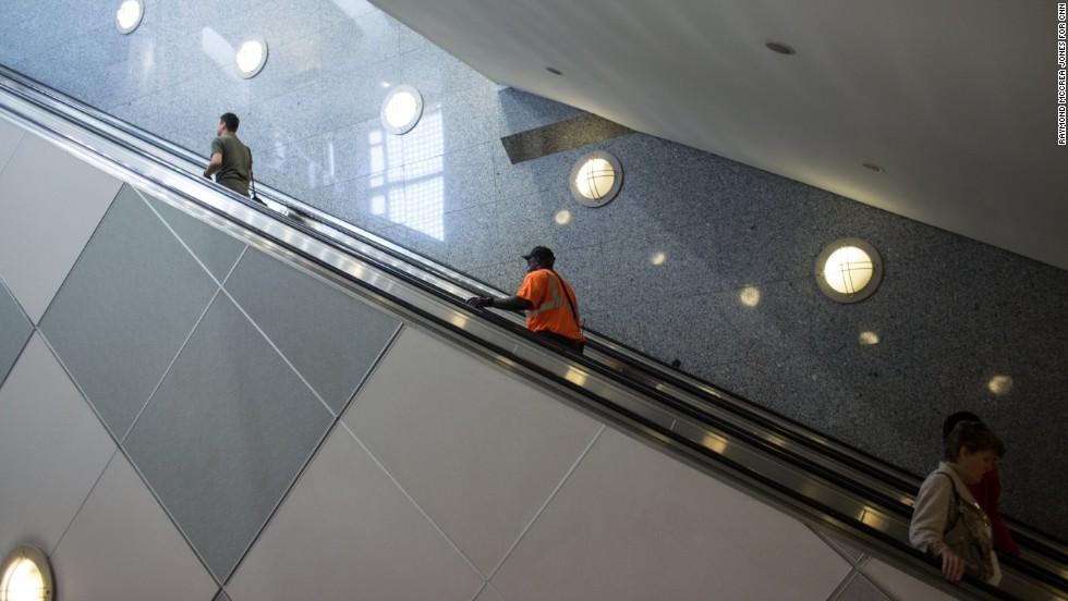 People ride an escalator near Concourse E.
