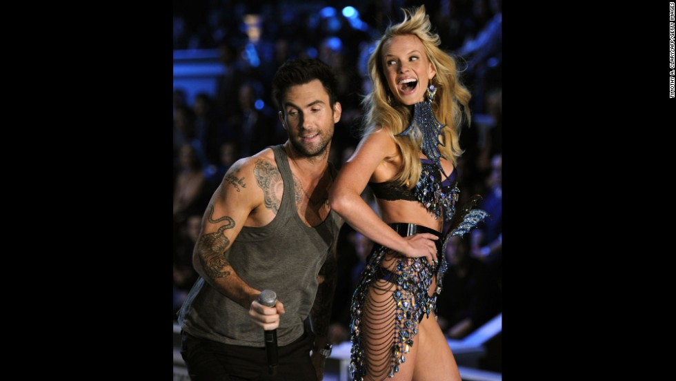 Levine performs with model Anne Vyalitsina during the 2011 Victoria's Secret fashion show in New York City.