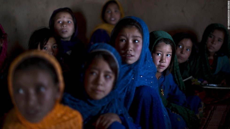 NOVEMBER 20 - ISLAMABAD, PAKISTAN: Official statistics released by the Federal Education Ministry of Pakistan give a desperate picture of education for all, especially girls, in the country. The overall literacy rate is 46 percent, while only 26 per cent of girls are literate. Pictured here, Afghan refugee girls attend a makeshift school set up in a mosque on the outskirts of the city.