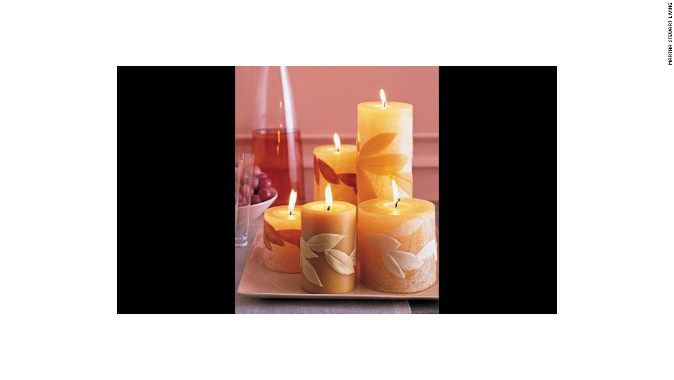 "Leaf-covered candles: <a href=""http://www.marthastewart.com/269676/leaf-covered-candles?xsc=synd_cnn"" target=""_blank"">Make your own candles</a> with natural leaves."