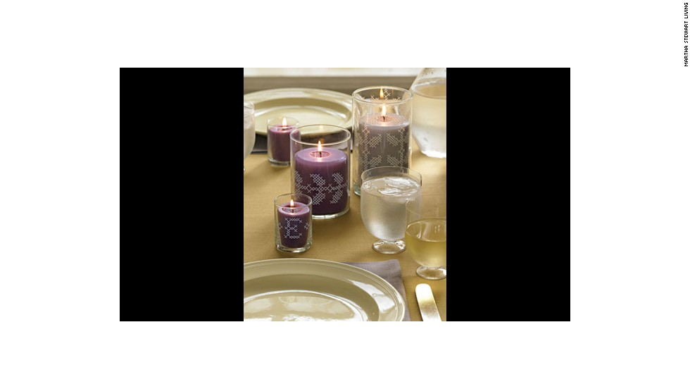 "No-stitch cross-stitch: <a href=""http://www.marthastewart.com/272383/no-stitch-cross-stitch?xsc=synd_cnn"" target=""_blank"">Make your own</a> votive holders for this centerpiece."