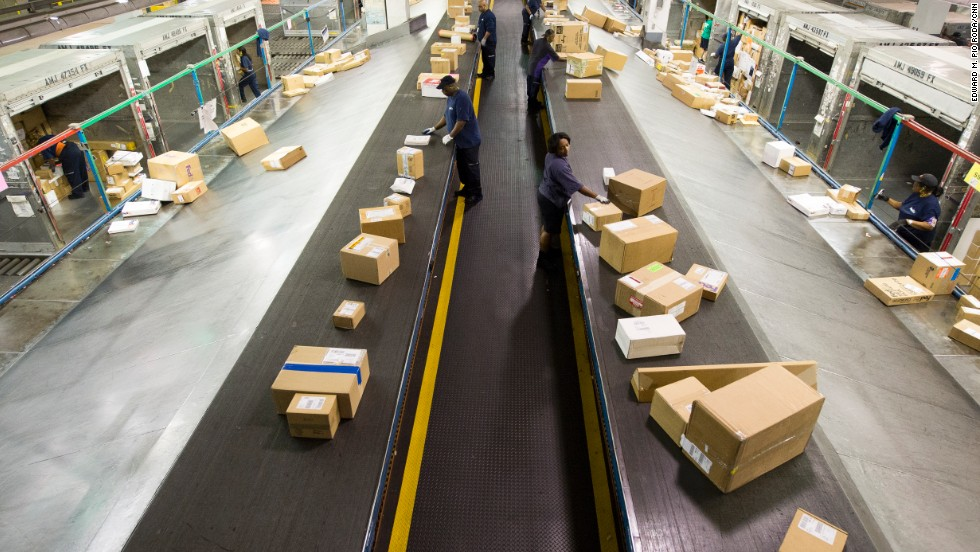 Packages are sorted at the FedEx cargo facility.