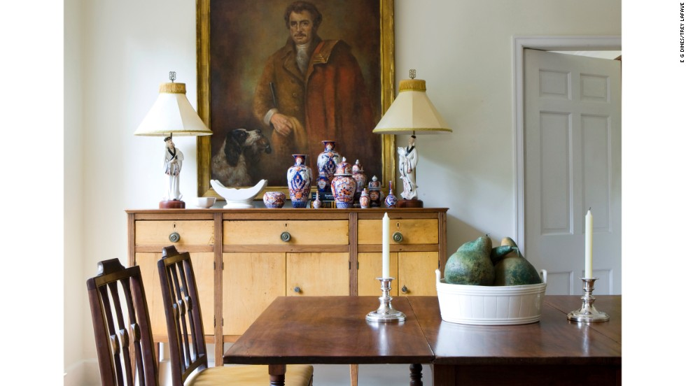 Trey LaFave's Atlanta dining room offers guests collections and elegant antiques to look at and enjoy during long dinners.