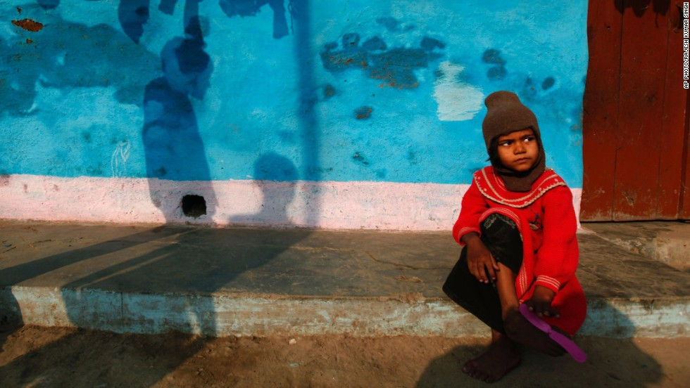 "NOVEMBER 21 - ALLAHABAD, INDIA: An Indian girl sits outside her home in a slum. Newly released<a href=""http://mospi.nic.in/Mospi_New/upload/women_men_india_2013_part1.pdf"" target=""_blank""> census data </a>shows families living in slums have a far better child sex ratio than the urban Indian average. The ratio of children aged 0 to 6 years old in an average slum household is 923 girls to every 1,000 boys, compared to 905 for urban households."