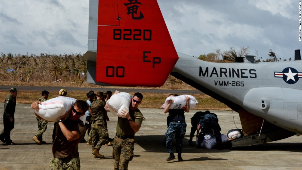 U.S. servicemen unload relief supplies from an Osprey aircraft Thursday, November 21, in Guiuan, Philippines.