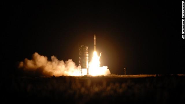 The Minotaur I rocket lifts off from NASA's Wallops Flight Facility in Virginia on Tuesday.