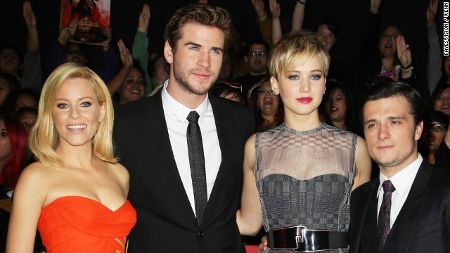 """Catching Fire"" stars Elizabeth Banks, from left, Liam Hemsworth, Jennifer Lawrence and Josh Hutcherson."