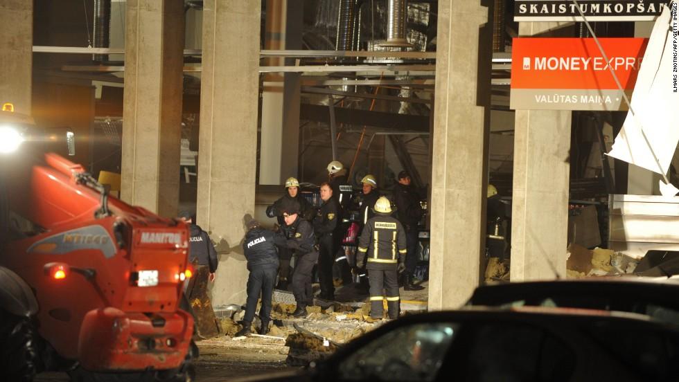 Rescue workers remove debris from the scene.