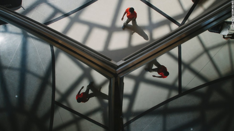 Passengers are reflected in the ceiling of the Domestic Terminal atrium.