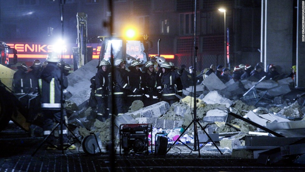Rescue workers outside the Maxima supermarket after the roof collapse on November 21.