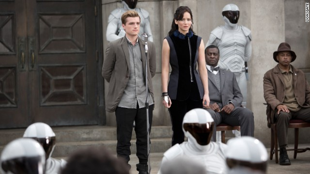 "Josh Hutcherson as Peeta Mellark and Jennifer Lawrence as Katniss Everdeen in ""The Hunger Games: Catching Fire."""