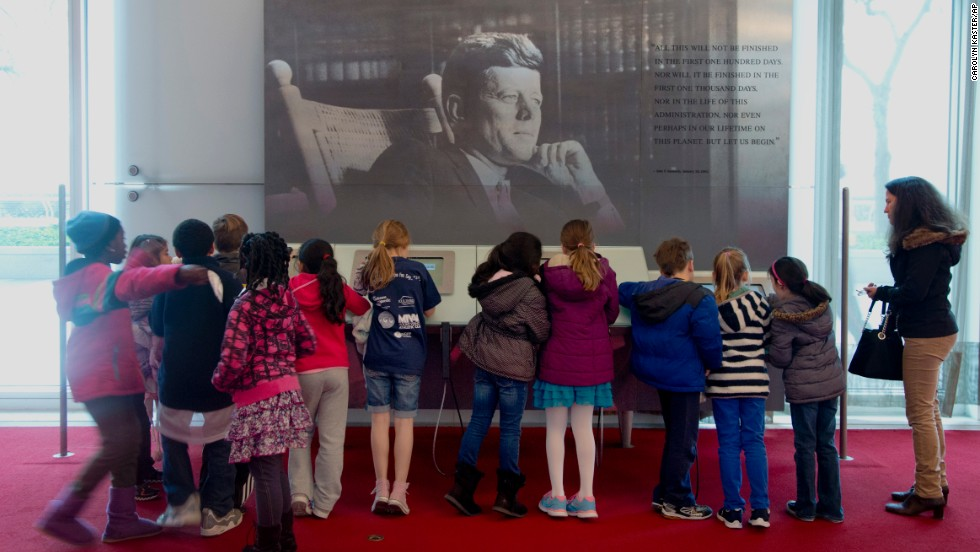 On the 50th anniversary of John F. Kennedy's death, children gather around a multimedia display Friday, November 22, in the grand foyer of the John F. Kennedy Center for the Performing Arts in Washington.
