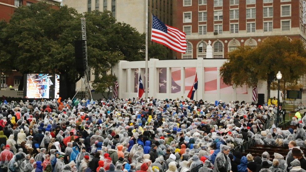 "People gather at Dealey Plaza on November 22. ""A new era dawned and another waned a half century ago when hope and hatred collided right here in Dallas,"" Rawlings said in his remarks."