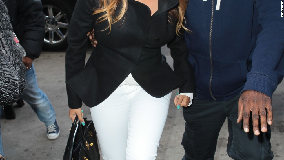 TV personality LaLa Anthony gets swarmed by photographers en route to see pal Kim Kardashian in New York on November 21.
