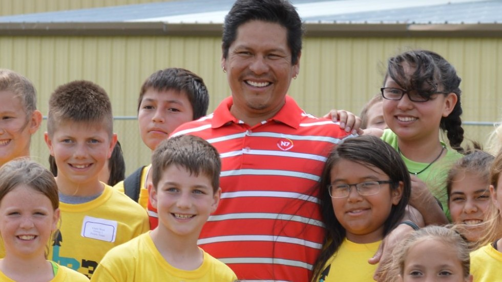 Begay welcomes a group of children who were participating in his health and wellbeing program.