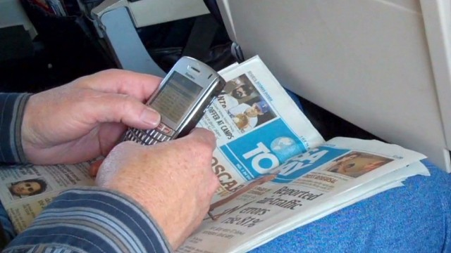 Cell phones on a plane could cost big $$