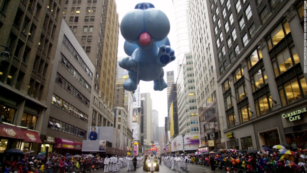 "Blue from ""Blues Clues"" rides high above the marchers in the 73rd parade in 1999."
