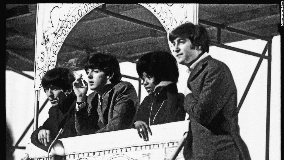 "Within a year of ""Please Please Me,"" the Beatles had performed before 75 million Americans on <em>The Ed Sullivan Show</em> and flown home to film <em>A Hard Day's Night </em>and record <em>Around the Beatles.</em>"