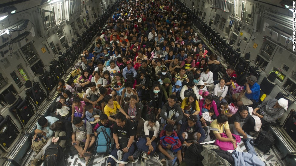 Approximately 400 Tacloban residents displaced by Typhoon Haiyan fill the cargo hold of a C-17 Globemaster military cargo plane on  Friday, November 22, 2013. Joint Task Force 505 personnel are conducting search and rescue, supply drops and personnel airlifts as part of relief efforts.