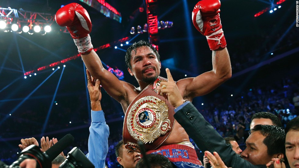 Manny Pacquiao wears the champion's belt after defeating Brandon Rios on Sunday, Nov. 24, 2013, in Macau.