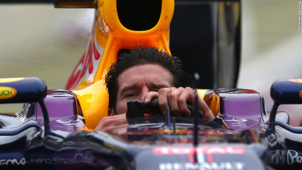 Mark Webber shed his helmet after crossing the line second in his final Grand Prix before departing to sports car racing.