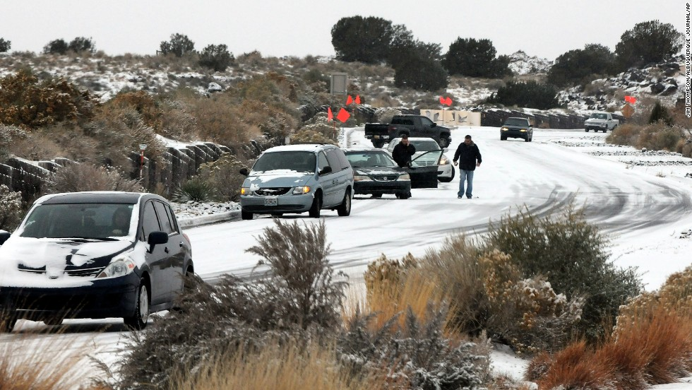 Cars slide on Paseo del Norte in Albuquerque on November 24.