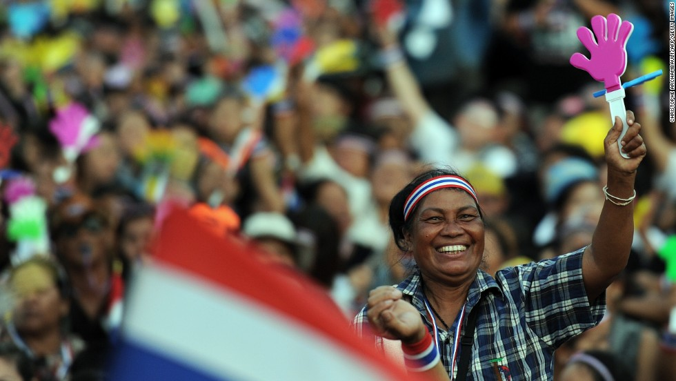 A Thai opposition protester waves a clapper during a rally at Bangkok's Democracy Monument Sunday.