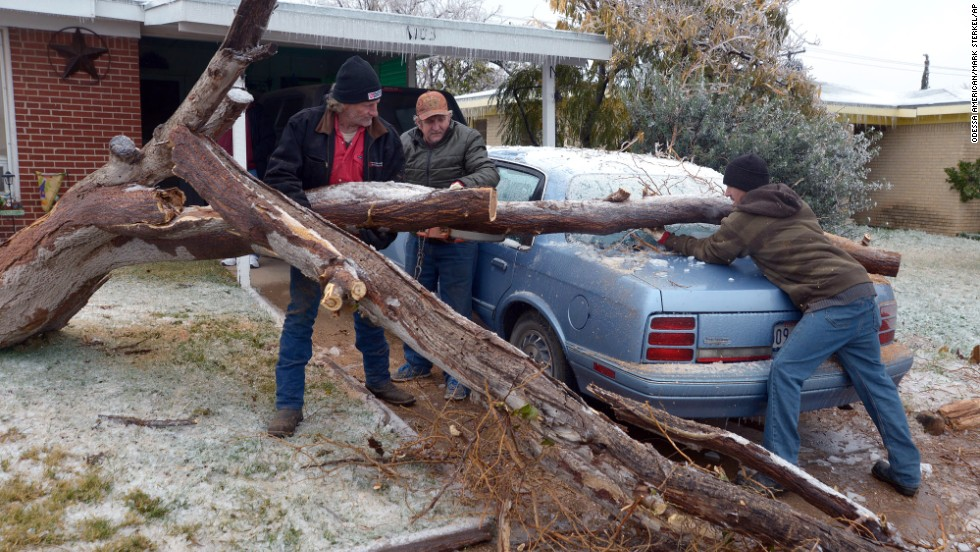 A fallen tree is removed from a car in Odessa, Texas, on November 25.