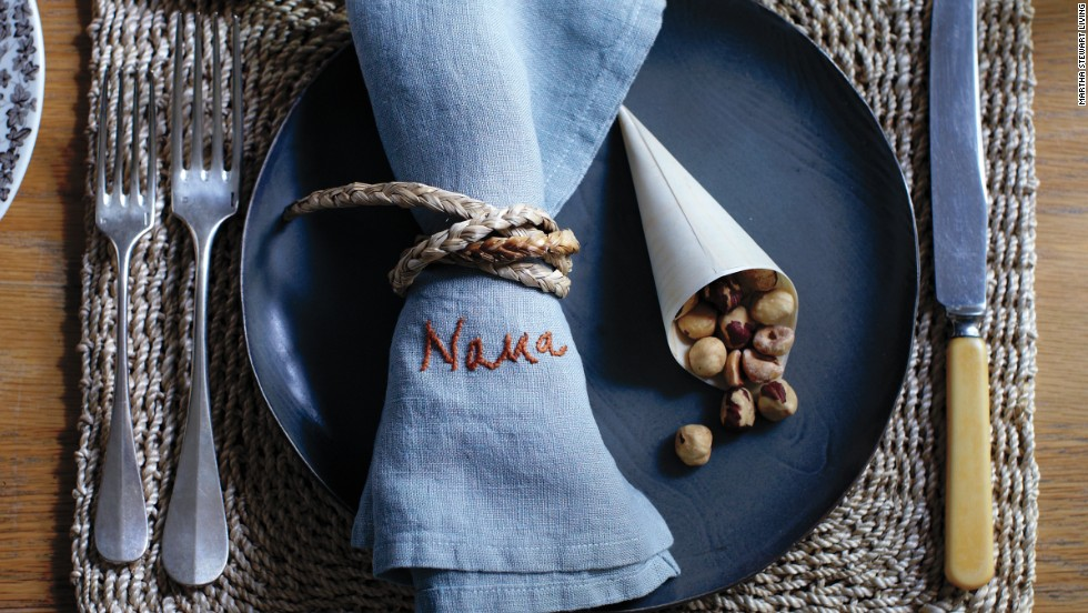 Round out place settings with individual horns of plenty—wood-veneer cones filled with nuts.