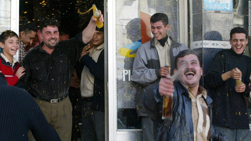 Iraqis celebrate in Nasiriyah, Iraq, after Hussein's capture.