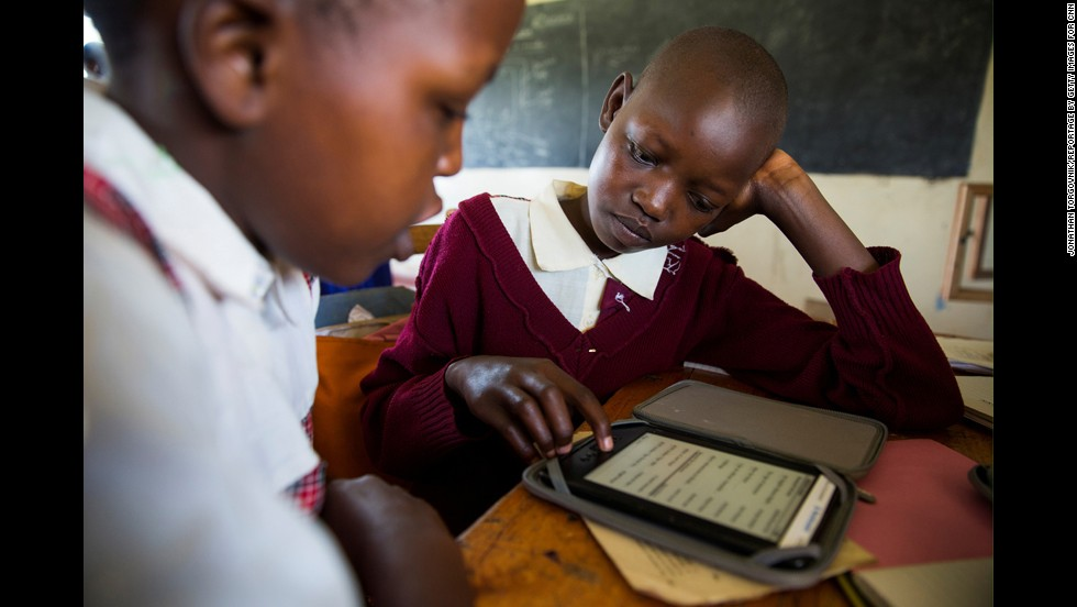 Girls at the school learn how to use the e-readers that were recently donated.